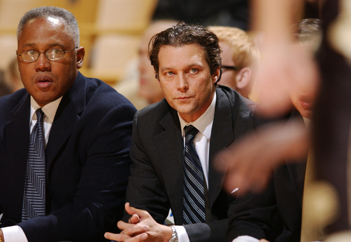 ** FILE ** Missouri head coach Quin Snyder, center, and associate head coach Melvin Watkins, left, watch their team play Oakland during the first half of a college basketball game Dec. 30, 2005, in Columbia, Mo. One day after saying he planned to finish the season, Snyder resigned Friday, Feb. 10, 2006. (AP Photo/L.G. Patterson, File)