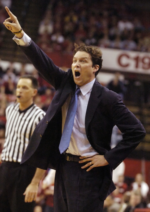 Missouri coach Quin Snyder shouts instructions to his players during their game against Nebraska in Lincoln, Neb., Saturday, Feb. 19, 2005. Missouri won 56-53. (AP Photo/Nati Harnik)
