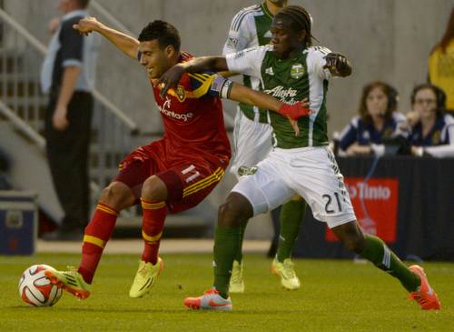 Rick Egan  |  The Salt Lake Tribune  Real Salt Lake midfielder Javier Morales (11) protects the ball, as Portland Timbers midfielder Diego Chara (21)defends, in MLS soccer action at Rio Tinto stadium, Saturday, June 7, 2014