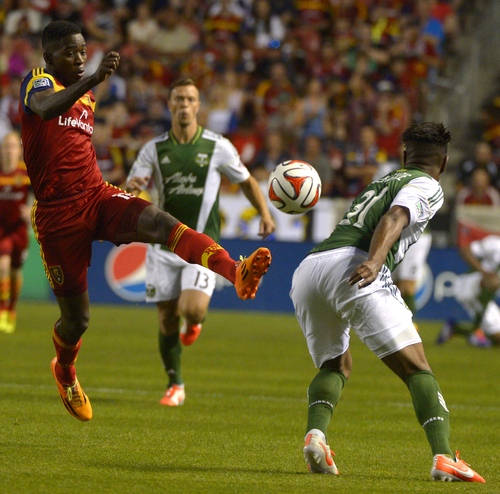 Rick Egan  |  The Salt Lake Tribune  Real Salt Lake forward Olmes Garcia (13) gets his foot on the ball, as Portland Timbers defender Rauwshan McKenzie (31) defends, in MLS soccer action at Rio Tinto stadium, Saturday, June 7, 2014