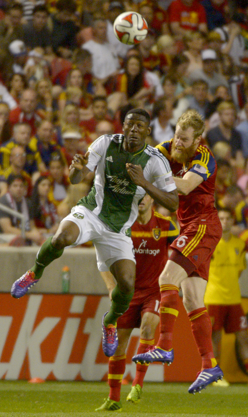 Rick Egan  |  The Salt Lake Tribune  Real Salt Lake defender Nat Borchers (6) goes for the ball along with Portland Timbers forward Frederic Piquionne (9), in MLS soccer action at Rio Tinto stadium, Saturday, June 7, 2014