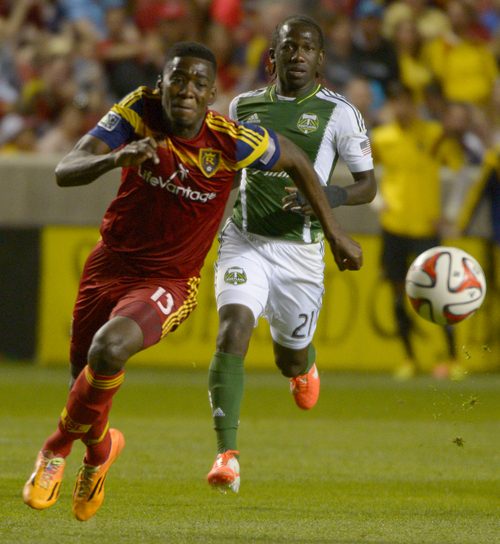 Rick Egan  |  The Salt Lake Tribune  Real Salt Lake forward Olmes Garcia (13) races Portland Timbers midfielder Diego Chara (21) for the ball,  in MLS soccer action at Rio Tinto stadium, Saturday, June 7, 2014