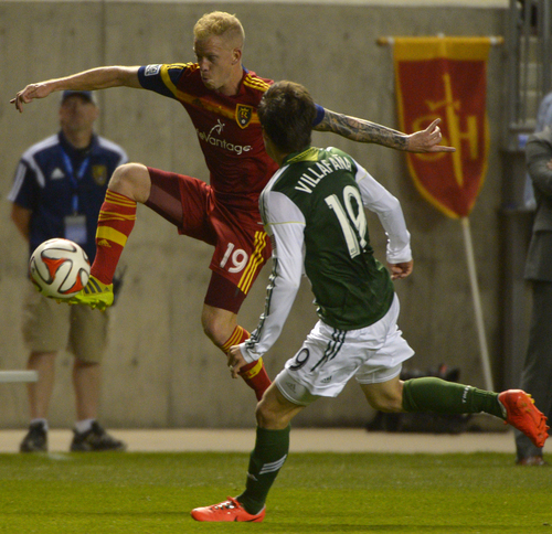 Rick Egan  |  The Salt Lake Tribune  Real Salt Lake midfielder Luke Mulholland (19) gets to the ball, as Portland Timbers defender/midfielder Jorge Villafana (19) defends, in MLS soccer action at Rio Tinto stadium, Saturday, June 7, 2014