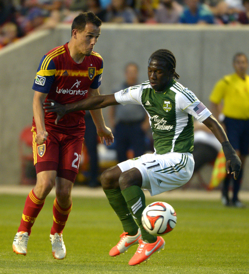 Rick Egan  |  The Salt Lake Tribune  Real Salt Lake midfielder Luis Gil (21) goes for the ball along with Portland Timbers midfielder Diego Chara (21), in MLS soccer action at Rio Tinto stadium, Saturday, June 7, 2014