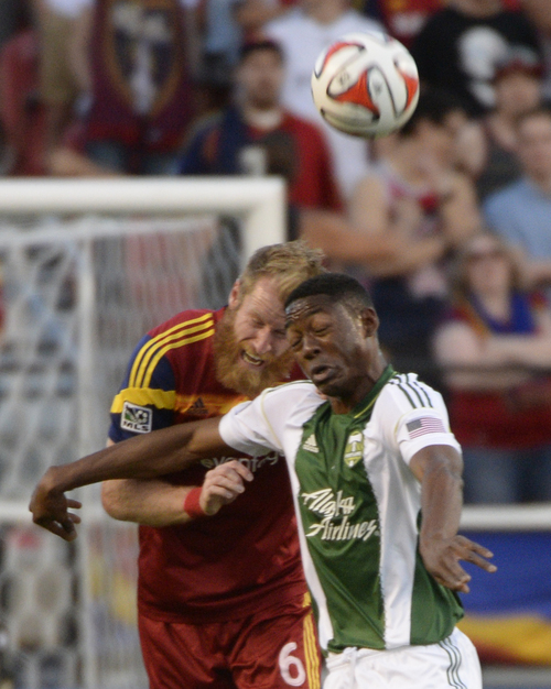 Rick Egan  |  The Salt Lake Tribune  Real Salt Lake defender Nat Borchers (6) collides with Portland Timbers forward Frederic Piquionne (9), in MLS soccer action at Rio Tinto stadium, Saturday, June 7, 2014