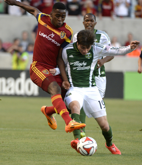 Rick Egan  |  The Salt Lake Tribune  Real Salt Lake forward Olmes Garcia (13) goes for the ball along with Portland Timbers defender/midfielder Jorge Villafana (19),  in MLS soccer action at Rio Tinto stadium, Saturday, June 7, 2014