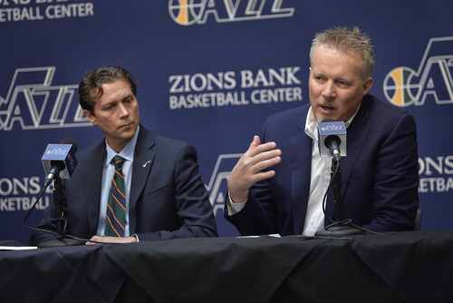 Scott Sommerdorf   |  The Salt Lake Tribune Quin Snyder listens at left as Jazz CEO Greg Miller talks about details of the hiring process. The Utah Jazz introduced Quin Snyder as their new head coach, Saturday, June 7, 2014.