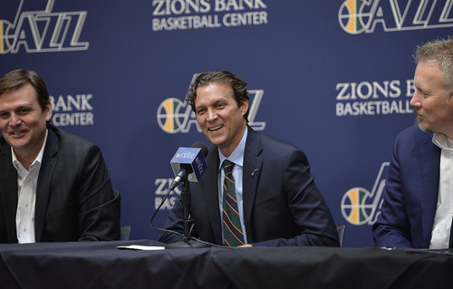 Scott Sommerdorf   |  The Salt Lake Tribune Quin Snyder smiles as he answers a question. Jazz GM Dennis Lindsey is at left, and Jazz CEO Greg Miller is at right. The Utah Jazz introduced Quin Snyder as their new head coach, Saturday, June 7, 2014.