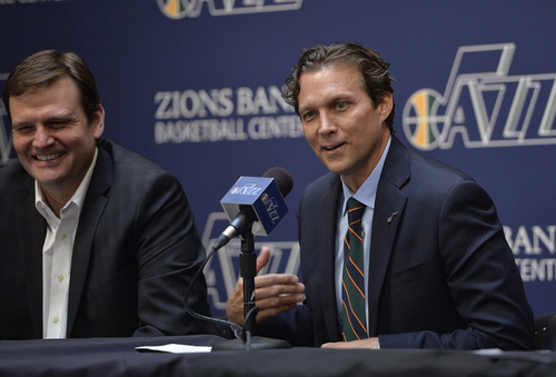 Scott Sommerdorf   |  The Salt Lake Tribune Quin Snyder smiles as he answers a question. Jazz GM Dennis Lindsey is at left. The Utah Jazz introduced Quin Snyder as their new head coach, Saturday, June 7, 2014.