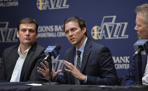 Scott Sommerdorf   |  The Salt Lake Tribune Quin Snyder gestures as he answers a question. Jazz GM Dennis Lindsey is at left, and Jazz CEO Greg Miller is at right. The Utah Jazz introduced Quin Snyder as their new head coach, Saturday, June 7, 2014.