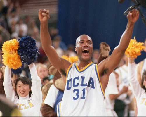 FILE - In this April 3, 1995 photo, UCLA's Ed O'Bannon celebrates after his team won the  championship NCAA game against Arkansas in Seattle.   O'Bannon won a collegiate basketball's national championship ring as a member of the 1995 UCLA Bruins. Sonny Vaccaro signed Michael Jordan to his first sneaker deal and made millions as a shoe company executive in charge of endorsements. Together they are seeking to radically alter the NCAA's multibillion dollar business model by leading a legal challenge that seeks a significant revenue share for amateur athletes who receive nothing but scholarships even when their images are used to sell video games, DVDs and other memorabilia.  (AP Photo/Eric Draper)
