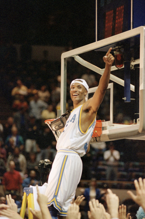 UCLA senior forward Ed O?Bannon celebrates as he cuts the down the net after defeating Connecticut 102-96 in the NCAA West Regional Championship in Oakland, Calif., on Saturday, March 25, 1995 to advance to the Final Four. (AP Photo/Susan Ragan)