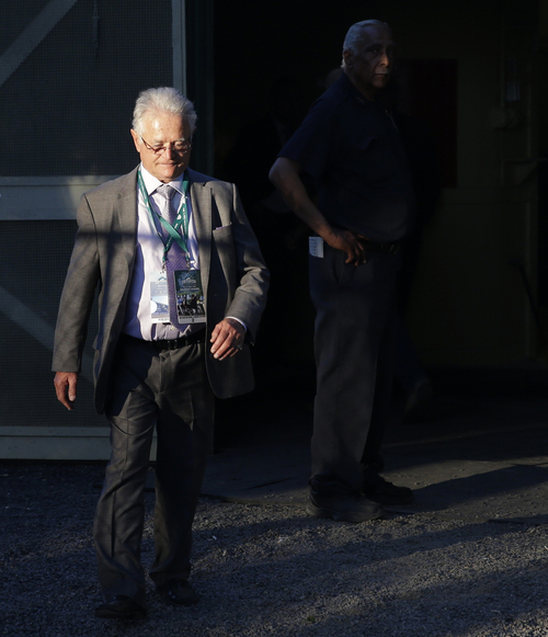 California Chrome trainer Art Sherman walks near a barn at Belmont Park after his horse finished fourth in the Belmont Stakes horse race, Saturday, June 7, 2014, in Elmont, N.Y. (AP Photo/Seth Wenig)