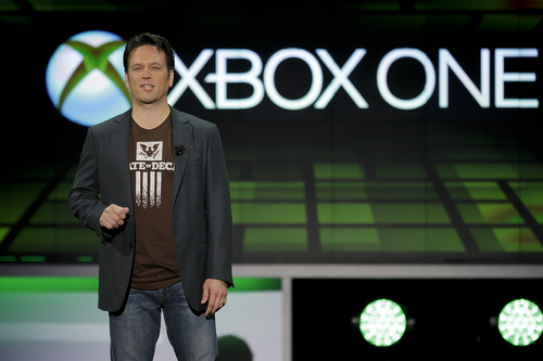 FILE - In this June 10, 2013 file photo, Phil Spencer of Microsoft Game Studios speaks at the Microsoft Xbox E3 media briefing in Los AngelesWith the launch of the Xbox One, PlayStation 4 and Wii U in the video game industry's rearview mirror, the spotlight at the Electronic Entertainment Expo, held June 10-12, 2014, is expected to shift back to games. From online-only titles to virtual reality experiences, about 200 exhibitors will  hype their latest software in hopes of driving away from E3 with The Next Big Thing. (AP Photo/Jae C. Hong, file)