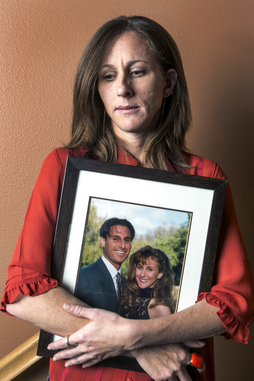 In this May, 15, 2014 photo, Kim Goldman holds a photo of her with her late brother, Ronald Goldman, murdered with his friend Nicole Brown Simpson in 1994, during an interview at her home in Santa Clarita, Calif. A civil jury awarded the Brown and Goldman families $33.5 million in wrongful death damages, which the Goldmans are still trying to collect. (AP Photo/Damian Dovarganes)