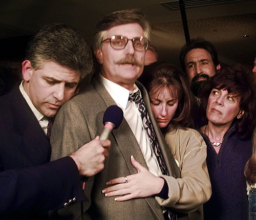 FOR USE SUNDAY, JUNE 8, 2014, AND THEREAFTER - FILE - In this Feb. 4, 1997 file photo, Fred Goldman, center, is hugged by his attorney Daniel Petrocelli, left, and daughter Kim, as his wife Patti, right, looks on, following the verdict in the wrongful death civil suit against O.J. Simpson in Santa Monica, Calif. Simpson was found liable for the deaths of Nicole Brown Simpson and Ronald Goldman. (AP Photo/Nick Ut, File)