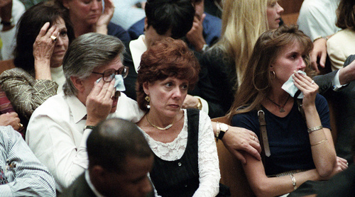 "FOR USE SUNDAY, JUNE 8, 2014, AND THEREAFTER - FILE - In this Sept. 26, 1995 file photo, Ron Goldman's father Fred Goldman wipes a tear as his wife Patti Goldman, center, and daughter Kim Goldman join him during the prosecution's closing arguments in the O.J. Simpson double-murder trial in Los Angeles. ""Our lives are a new and different normal now ... But you find a way somehow or other to adjust to the pain, to the anger, to the loss, "" said Fred Goldman. (AP Photo/Myung J. Chun, Pool, File)"