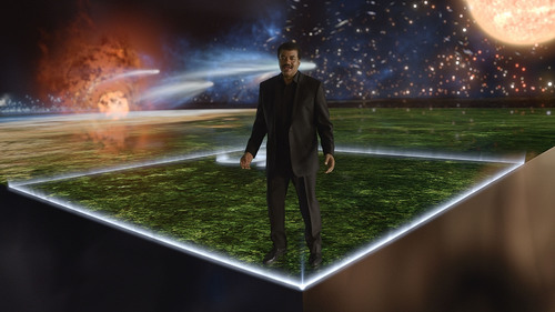 """Host and astrophysicist Neil deGrasse Tyson walks across the Cosmic Calendar, on which all of time has been compressed into a year-at-a-glance calendar, from the Big Bang to the moment humans first make their appearance on the planet in the all-new """"Standing Up in the Milky Way"""" premiere episode of """"Cosmos: A Spacetime Odyssey."""" (Courtesy Fox)"""