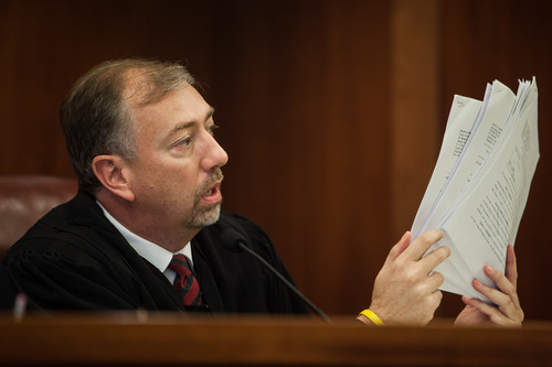 Judge Eric A. Ludlow holds up court documents as he addresses Troy James Knapp during a sentencing hearing at the Fifth District Court in St. George, Utah on Monday, June 9, 2014. Trevor Christensen / The Spectrum & Daily News
