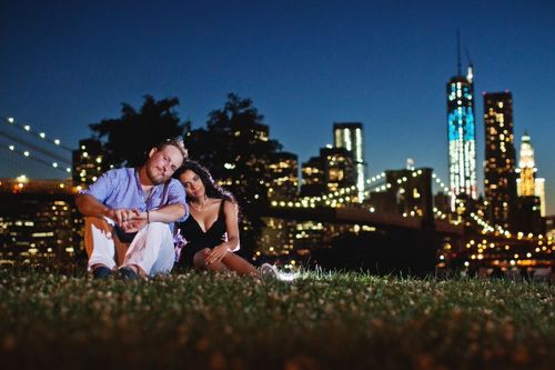 This 2013 photo provided by I Heart New York shows Kristain and Anzalee Rhodes at Brooklyn Bridge Park, in New York. Anzalee was eight months pregnant in the picture. The couple are hiring photographers from I Heart New York to document their experiences as young parents. Hiring professional photographers to capture everyday life and not just important events like weddings has become a lifestyles trend. (AP Photo/I Heart New York)