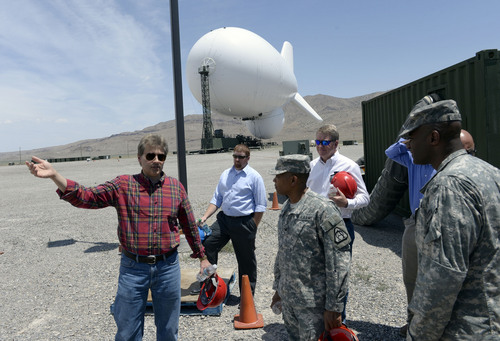 Al Hartmann  |  The Salt Lake Tribune Officials from Raytheon and U.S Army battery tour the JLENS a last time at Utah Test and Training Range Tuesday June 10.    The JLENS which is 74 meters long will be moved from Utah to the Aberdeen Proving Ground in Maryland to integrate with NORAD.