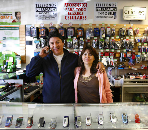 West Valley City - Jorge Rivadeneira (left) manages the cel phone shop Ecuacell, one of about 15 businesses located in a small strip mall in West Valley City where all of the businesses are ethnic. Most are either Latino or Vietnamese. Rivadeneira and his wife Maria Rivadeneira (right) are immigrants from Ecuador. Trent Nelson/The Salt Lake Tribune; 11.20.2007