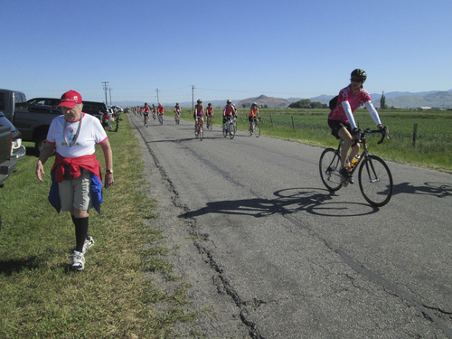 Kristen Moulton | Salt Lake Tribune  Alice Telford, founder of the Little Red Riding Hood all-women cycling ride, walks along as riders pass on Saturday, June 7, 2014, in Lewiston, Cache County. Telford, now 90, last rode in Little Red three years ago.