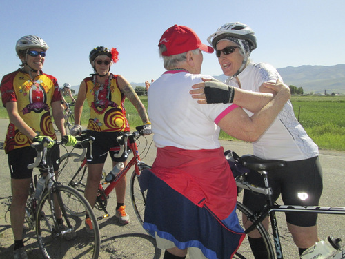 Kristen Moulton | Salt Lake Tribune  Alice Telford, left, greets Margy Batson, as Batson and her friends begin to ride in the Little Red Riding Hood all-women cycling event on Saturday, June 7, 2014, in Cache Valley. Telford, now 90, founded Little Red, and last rode three years ago.
