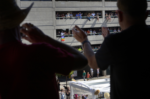 Scott Sommerdorf   |  The Salt Lake Tribune People cheer from one of the elevated spots inside a parking garage on the south side of 200 South at the Salt Lake City Pride Parade, Sunday, June 7, 2014.