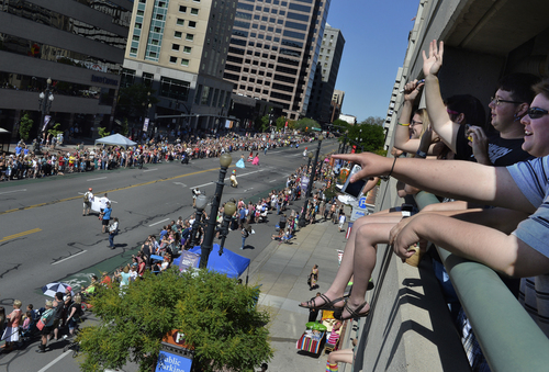 Scott Sommerdorf   |  The Salt Lake Tribune Spectators watch the Salt Lake City Pride Parade from a parking garage on 300 South, Sunday, June 7, 2014.