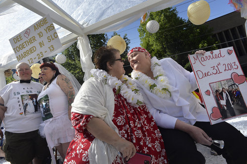 Scott Sommerdorf   |  The Salt Lake Tribune Shelly Eyre, left, and her spouse Cheryl Hause kiss aboard the marriage float at the Salt Lake City Pride Parade, Sunday, June 7, 2014.