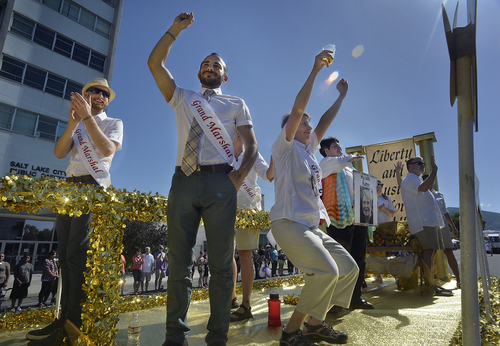 Scott Sommerdorf   |  The Salt Lake Tribune Derek Kitchen and his spouse Moudi Sbeity, center, wave to the crowd as they and other married couples take part in the Salt Lake City Pride Parade aboard the Liberty and Justice for All float, Sunday, June 7, 2014.