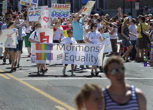 Scott Sommerdorf      The Salt Lake Tribune Mormons for Equality marches in the Salt Lake City Pride Parade, Sunday, June 7, 2014.