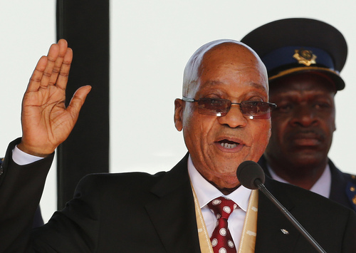 FILE : in this Saturday, May 24, 2014 file photo South African President Jacob Zuma is sworn in for a second term in Pretoria, South Africa. Officials said Tuesday, June 10, 2014 that Zuma is missing a three-day Cabinet meeting this week while resting after hospital tests. The president's office previously said he was discharged from a hospital  on Sunday after a weekend checkup following a demanding schedule. (AP Photo/Siphiwe Sibeko, Pool, File)