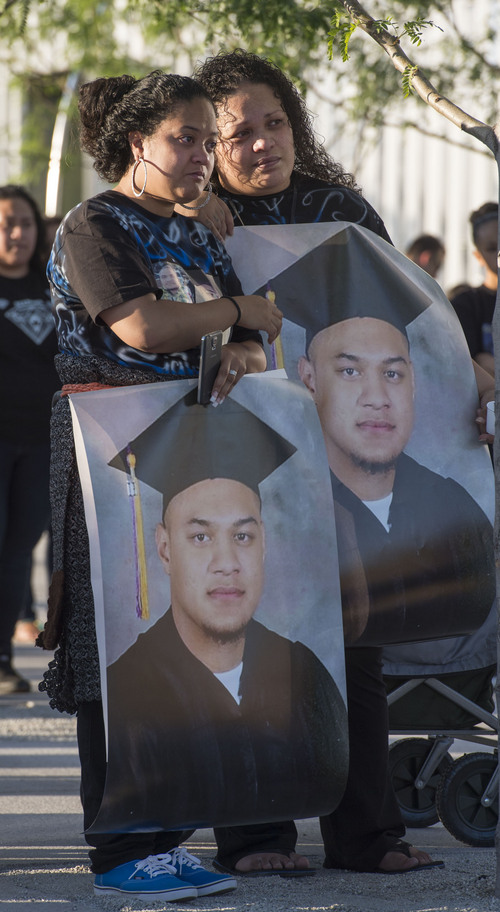 "Steve Griffin  |  The Salt Lake Tribune   Siola'a Nau and Tolina Tausinga, sisters of, Siale Angilau, who was shot and killed in the Salt Lake City federal courthouse, hold posters of their brother during the Justice4Siale Vigil on the courthouse plaza in Salt Lake City, Utah Wednesday, June 11, 2014.  Glendale community members have organized a coalition called the ""Raise your Pen Coalition."""