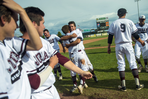Chris Detrick  |  The Salt Lake Tribune Jordan's Ryan Sedillo (19) and Koleton Papic (6) hug as they celebrate with their teammates after winning the 5A state championship at Brent Brown Ballpark Friday May 23, 2014. Jordan defeated Pleasant Grove 4-3.