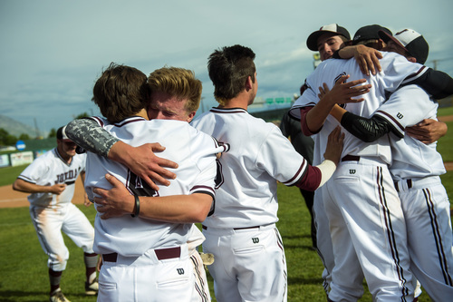 Chris Detrick  |  The Salt Lake Tribune Jordan's  Koleton Papic (6) and Jackson Bolingbrook (4) hug as they celebrate with their teammates after winning the 5A state championship at Brent Brown Ballpark Friday May 23, 2014. Jordan defeated Pleasant Grove 4-3.
