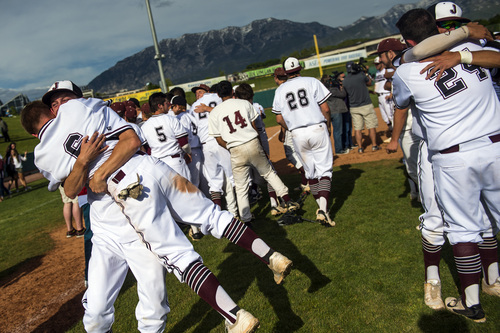 Chris Detrick  |  The Salt Lake Tribune Jordan's Cody Davis (1) and Koleton Papic (6) hug as they celebrate with their teammates after winning the 5A state championship at Brent Brown Ballpark Friday May 23, 2014. Jordan defeated Pleasant Grove 4-3.