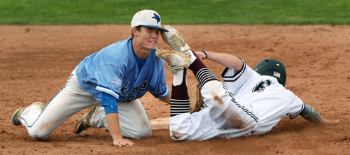 Steve Griffin  |  The Salt Lake Tribune   Pleasant Grove shortstop Easton Walker tags out Jordan runner Koleton Papic during the 5A State baseball championship game  at Brent Brown Ballpark on the UVU campus in Orem, Utah Friday, May 23, 2014.
