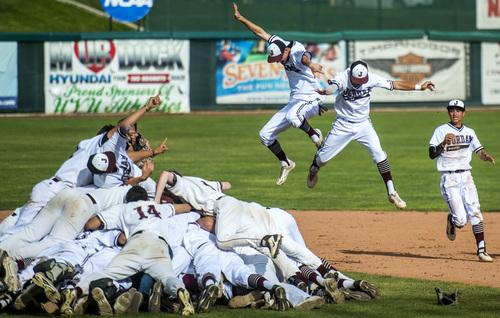 Chris Detrick  |  The Salt Lake Tribune Members of the Jordan baseball team celebrate after winning the 5A state championship at Brent Brown Ballpark Friday May 23, 2014. Jordan defeated Pleasant Grove  4-3.