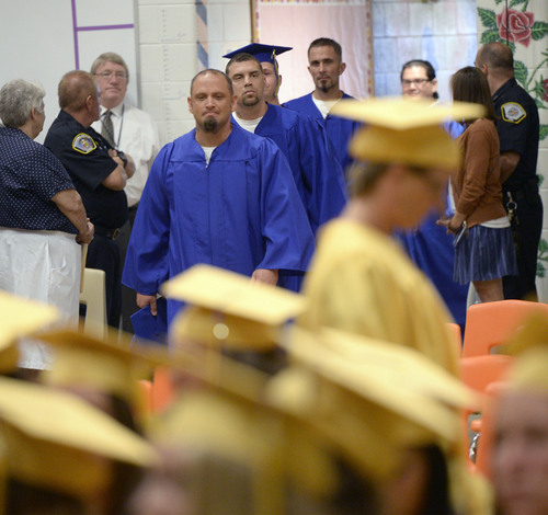 Al Hartmann  |  The Salt Lake Tribune Inmates walk in a graduation procession at the Utah State Prison in Draper Wednesday June 11, 2014. Two hundred seventy-three male and female inmates received their high school diplomas.
