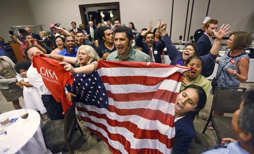 Immigration reform supporters crash the primary-night party of House Majority Leader Eric Cantor, R-Va., after he delivered a concession speech in Richmond, Va., Tuesday, June 10, 2014. Cantor lost in the GOP primary to tea party candidate Dave Brat. (AP Photo/Steve Helber)