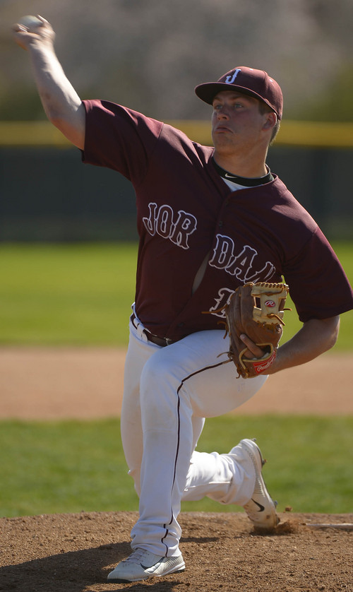 Leah Hogsten  |  The Salt Lake Tribune Jordan's starting pitcher Colton Shaver during their game with West Jordan High School, Friday, April 11, 2014.