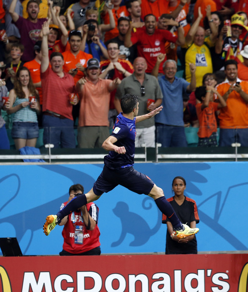 Netherlands' Robin van Persie celebrates after his scoring his side's fourth goal during the second half of the group B World Cup soccer match between Spain and the Netherlands at the Arena Ponte Nova in Salvador, Brazil, Friday, June 13, 2014. (AP Photo/Wong Maye-E)