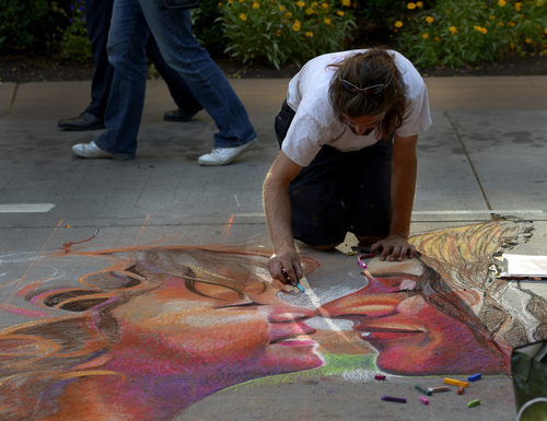 Leah Hogsten     The Salt Lake Tribune Rod Peterson brings the likeness of his wife Justine and son Van, 2, to life in pastels at the 12th Annual Utah Foster Care Chalk Art Festival, Friday, June 13 through Saturday, June 14 at The Gateway. Proceeds benefit Utah Foster Care.