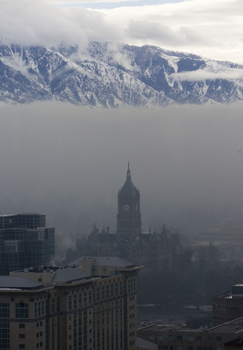 Jim Urquhart | The Salt Lake Tribune The Wasatch Mountains are clear above the inversion and smog that hangs over the valley and the Salt Lake City & County building Friday, January 23, 2008 in Salt Lake City. The inversion is expected to improve over the weekend.
