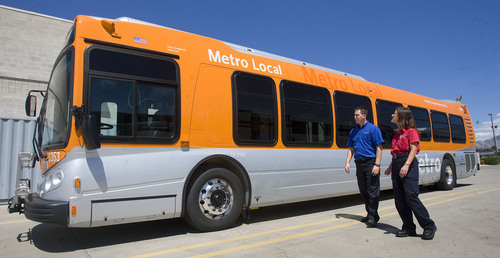 Al Hartmann  |  The Salt Lake Tribune UTA will test two CNG powered buses.  Bus operators Brett Morrill, left,  and Carol Quigley take a look at one borrowed from the Los Angeles Metro Local Bus Company at the UTA headquarters at 3600 South and 700 West on Tuesday August 17th.