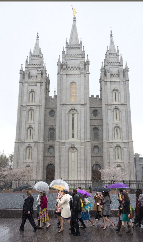 Steve Griffin  |  The Salt Lake Tribune   Members and supporters of the Ordain Women walk in front of the Temple on their way to the Tabernacle on Temple Square to seek standby tickets to the all-male general priesthood meeting in Salt Lake City, Utah Saturday, April 5, 2014.