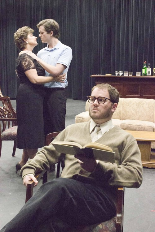 """Courtesy Photo  Teresa Sanderson as Martha and Mike Brown as Nick share an illicit embrace while Jared Larkin as George looks on in a scene from Pinnacle Acting Company's production of """"Who's Afraid of Virginia Woolf?"""" to be staged in the Jewett Center for the Performing Arts at Westminster College June 12-28."""