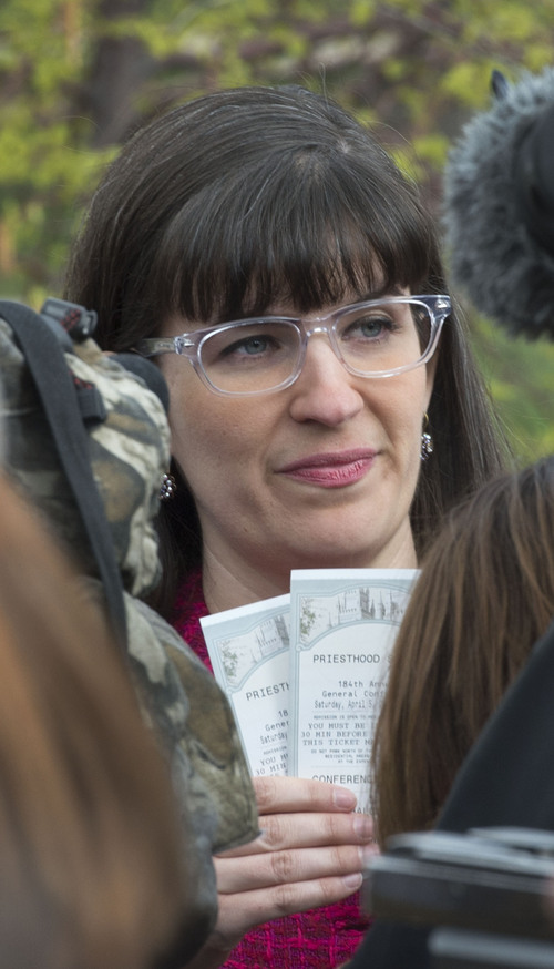 Steve Griffin  |  The Salt Lake Tribune   Kate Kelly, of the group Ordain Women, holds two tickets to the general priesthood meeting that were given to her by two men, during the groups devotional at City Creek Park  in Salt Lake City, Utah Saturday, April 5, 2014. The group then walked over to the Tabernacle on Temple Square to seek standby tickets to the all-male general priesthood meeting.